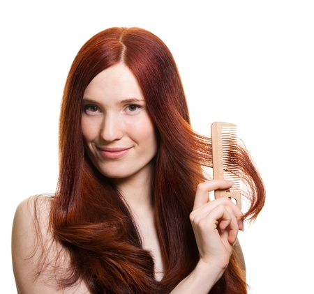 portrait of a beautiful young woman comb wonderful hair Stock Photo - 9369470