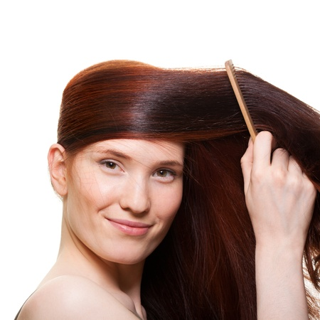 portrait of a beautiful young woman comb wonderful hair Stock Photo - 9369460