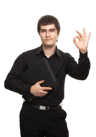 man in black shirt with book show ok sign Stock Photo - 9369457