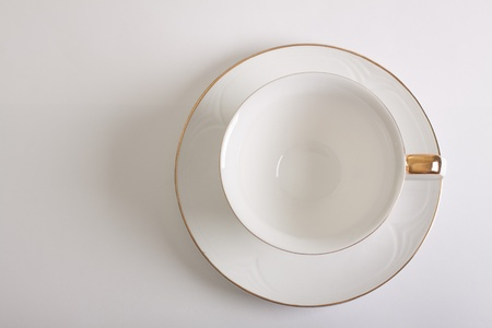 white empty cup and saucer top view photo