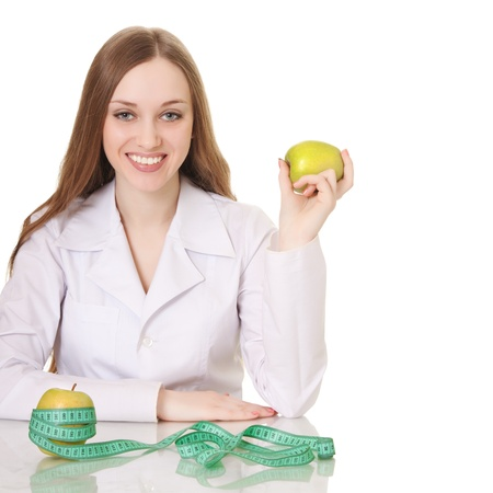 Healthy eating or lifestyle concept. woman doctor with a green apple.  photo