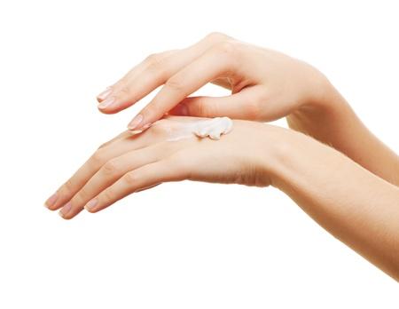 crème: ragazza di bellezza applicando alcuni lozione bianco sulla sua mano