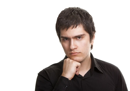 young frustrated man in black shirt isolated on white background photo