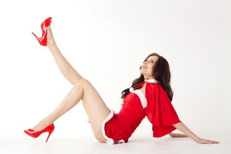 moment: happy smiling woman in red xmas sexy costume on white background