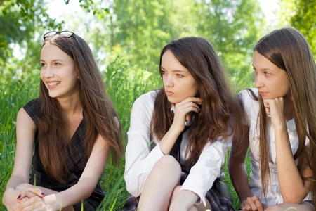three beautiful smile student girl in the park  photo