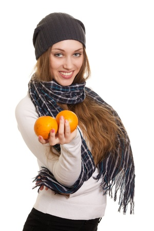 winter woman: Happy woman with orange on white background Stock Photo