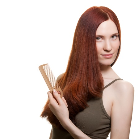portrait of a beautiful young woman comb wonderful hair Stock Photo - 9615150