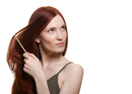 portrait of a beautiful young woman comb wonderful hair  Stock Photo - 9615152