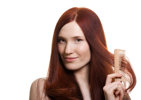 portrait of a beautiful young woman comb wonderful hair  Stock Photo - 9613470