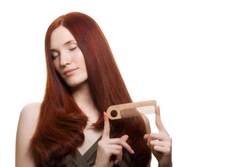 portrait of a beautiful young woman comb wonderful hair  Stock Photo - 9613215