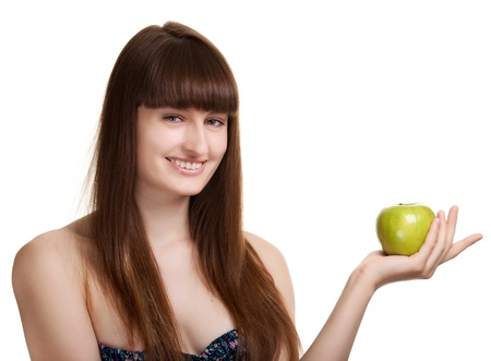 Young happy smiling woman with green apple isolated on white photo