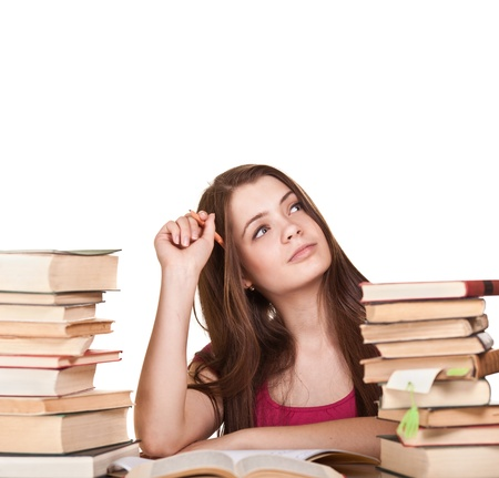 literatura: Teen girl learning at the desk, with lot of books around, isolated on white  Reklamní fotografie