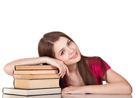 Teen girl with lot of books, isolated on white Stock Photo - 9617592