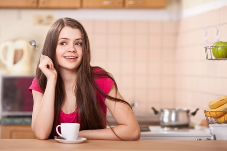 beautiful happy young woman drinking coffee at home Stock Photo - 9613484