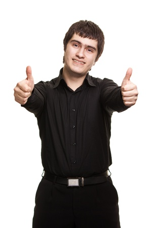 Portrait of young man in black shirt gesturing thumbs-up sign against white background  photo