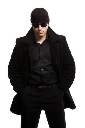 vigilante: confidence man in black coat and sunglasses