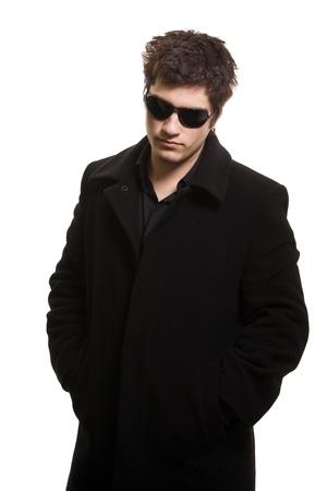 vigilance: confidence man in black coat and sunglasses