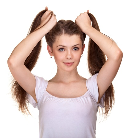 Portrait of a beautiful teen girl with long hairs and clean skin of the face - isolated on white Stock Photo