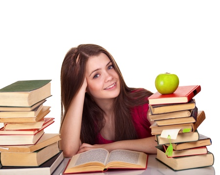 Teen girl with lot of books, isolated on white  Stock Photo - 9809358