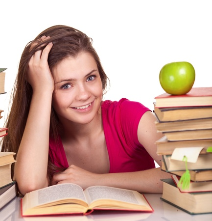 Teen girl with lot of books, isolated on white  photo