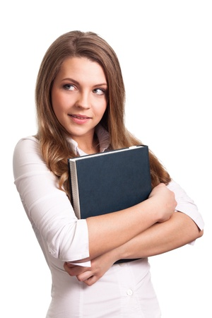 Attractive woman smiling while holding book  photo