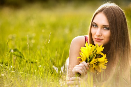 outsides: beautiful young blonde woman on the meadow on a warm summer day