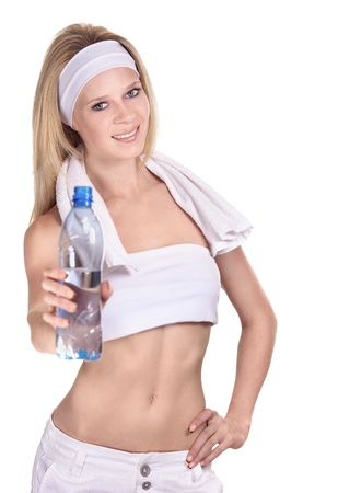 Attractive smiling sportswoman with a bottle of mineral water photo