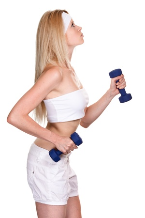 Portrait of a sporty woman with a dumbbell on white background  photo