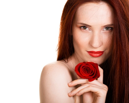 Portrait of sensual beautiful woman with red rose on white background photo