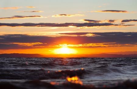 rea: sunset at coast of the sea