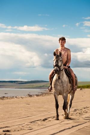 Horseman on the beach photo