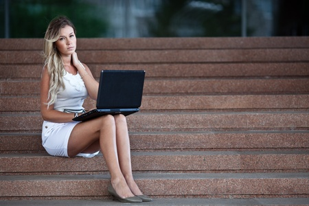 secretary skirt: Young attractive businesswoman with a notebook  Stock Photo