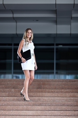 Young attractive businesswoman with a notebook  photo