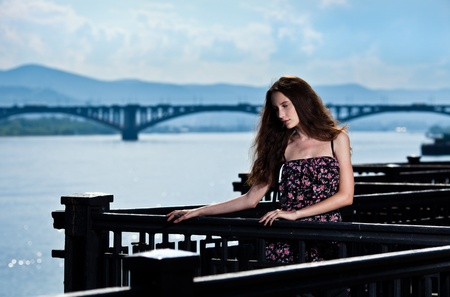 Portrait of the beautiful woman with bridge city background  photo