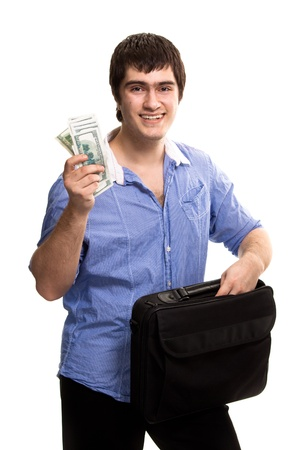 paying money: Young handsome man with case holding dollars