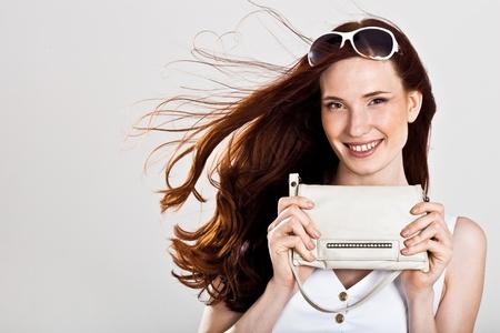 Beautiful sexy caucasian woman with purse photo