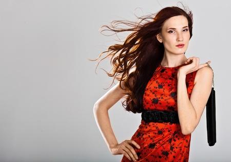Beautiful sexy caucasian woman in stylish dress. Studio shot  photo