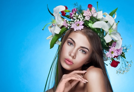 perfect face: Beautiful woman with flower wreath. Space for text.