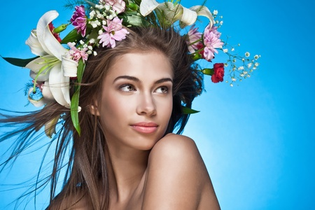 Beautiful woman with flower wreath. Space for text.  Stock Photo - 10487730