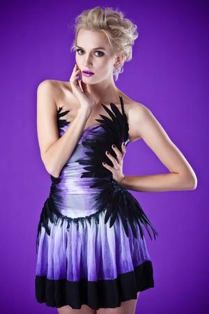 beautiful luxurious woman on purple background photo