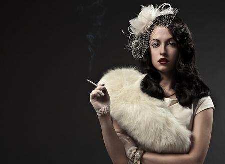smoker: Beautiful smoking woman. Retro portrait  Stock Photo