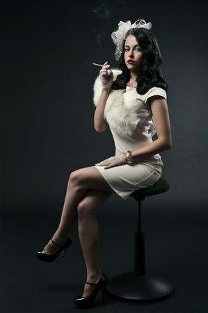 Beautiful smoking woman. Retro portrait  photo