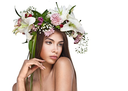 beauty model: Beautiful woman with flower wreath. Space for text.