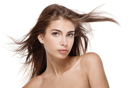 Beautiful woman with fluttering hair isolated photo