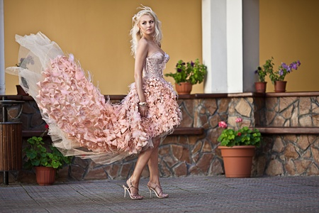 Blond beautiful luxury woman in wedding dress photo