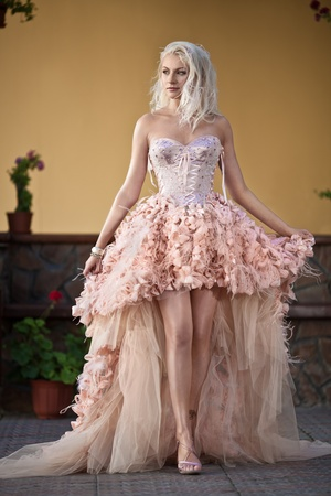 Blond beautiful luxury woman in wedding dress photo
