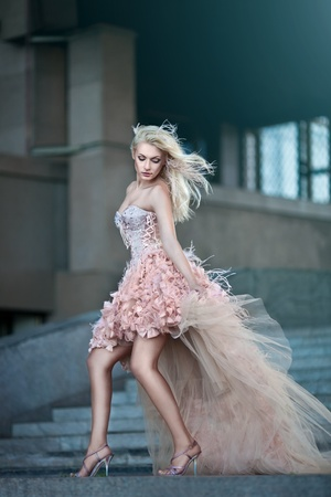 Blond beautiful luxury woman in wedding dress