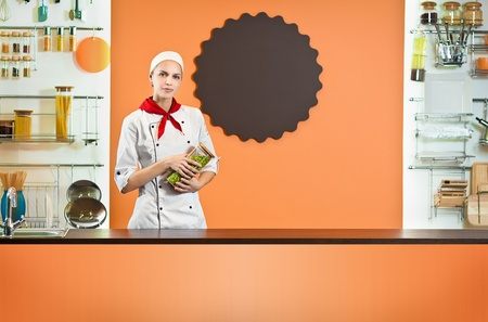 interior shot: Woman chef in the modern kitchen interior Stock Photo