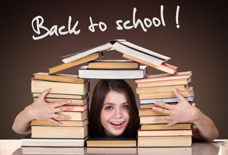 exams: Teen girl with lot of books around, back to school Stock Photo