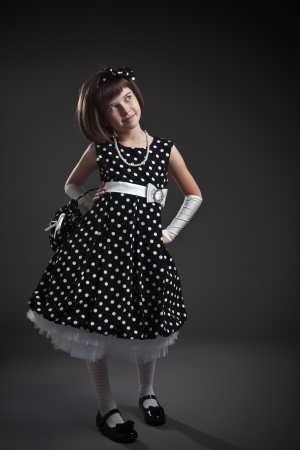 Standing elegant old-fashioned dressed little girl  photo